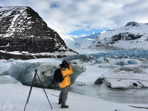 One of Jansen Photo Expeditions clients photographing amazing glaciers in Iceland, during one of our photography workshops.